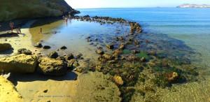 Kleiner, natürlicher Badeteich am Playa de las Palmeras – Spain